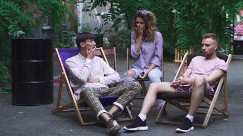 Young people sit at comfortable chairs and chatting Footage