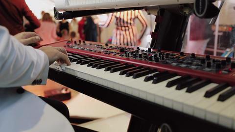 Close up shot of musician playing keyboards GIF