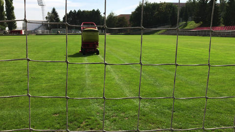 Grass-cutting vehicle cuts grass on football field Footage