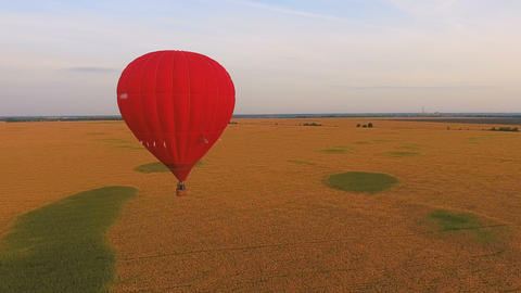 Air balloons flying over rural fields, contestants of ballooning championship Live Action
