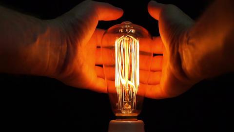 Man Antique Filament Bulb Hands Warming POV Footage