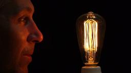 Man Antique Filament Bulb Amusement Side Footage