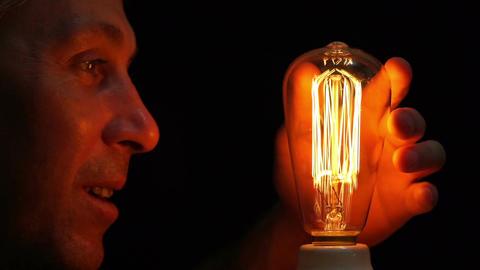 Man Antique Filament Bulb Amusement Side Hand Footage