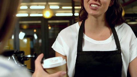 Barista giving coffee to a customer Live Action