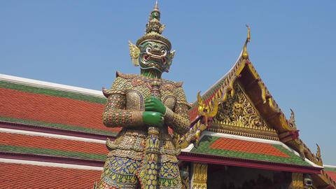 Giant demon statue in Wat Phra Kaew in Bangkok Footage