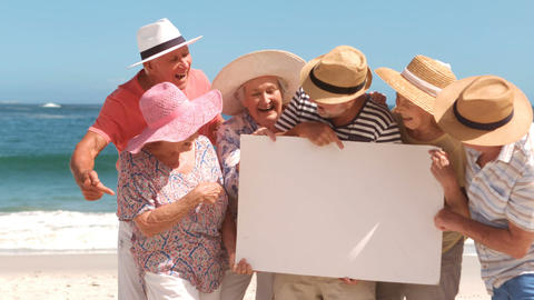 Group of mature people looking a white sign Footage