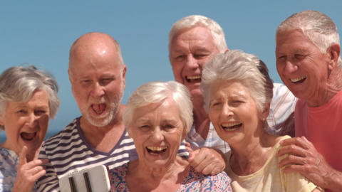 Group of mature people taking a photo Footage