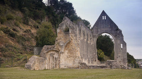 Ruined exterior of priory of Beaumont le Roger, Normandy France Live Action