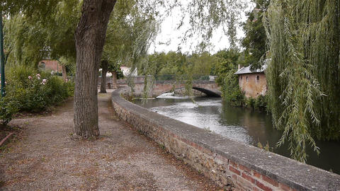 River, bridge and park in Broglie, Normandy France Footage