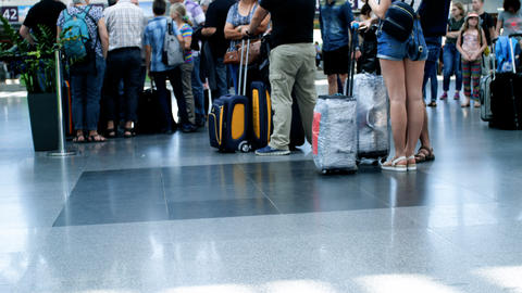 Out of focus 4k footage of people feet and luggage at international airport Footage