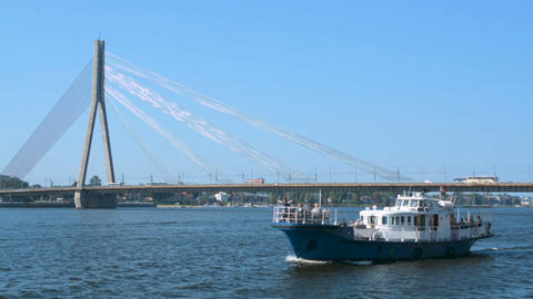 River ferry tourist attraction in Riga in front of a cable bridge, weekend Live Action