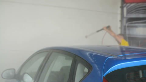 Self-service car washing station concept, washing car with water jet inside Footage