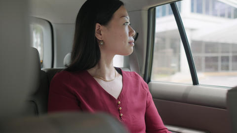 Chinese Business Woman Working In Taxi Going To Work Footage