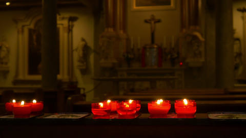 Red candles in a church 4K Live Action