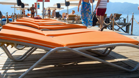 4k footage of sunbeds and people relaxing on wooden pier... Stock Video Footage
