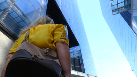Businesswoman Walks In Highrise Glass Offices Footage