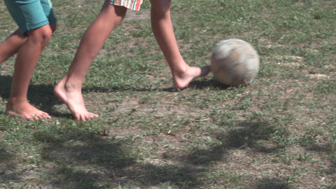 Children play football with an old ball Footage