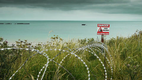 Memorial beach and barbed wire at Arromanches, France Archivo