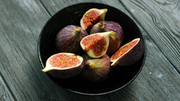 Bowl full of cut figs Footage