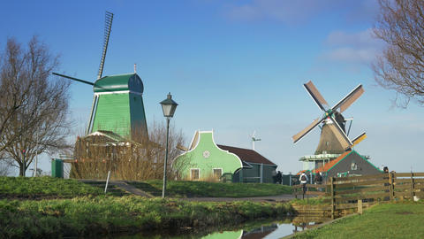 Historic wooden houses and windmills at the Zaanse Schans. Holland 4K Footage