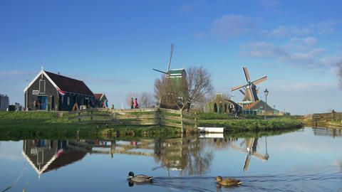 Touristic wooden houses and windmills at the Zaanse Schans. Holland 4K Footage
