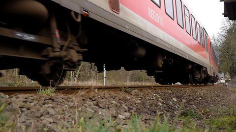Train passing by close on railway in Eifel, Germany Footage