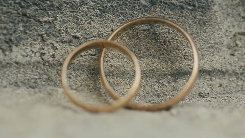 Two wedding rings in infinity sign. Love concept Footage