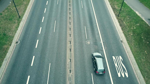 Low altitude aerial shot of city highway with bus lanes Live Action