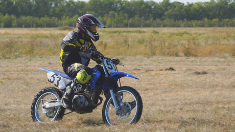 Enduro racer rides a motocross bike Archivo