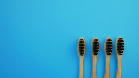 Black and white bamboo toothbrushes Live Action