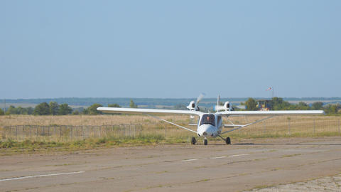 Light private twin-engined aircraft plane on the runway Live Action