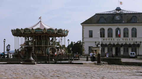 Rotating carousel in harbor of Honfleur, France Footage