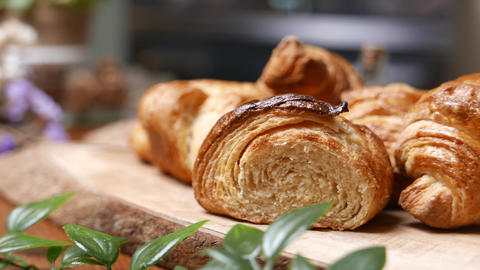 Fresh croissant a flaky, viennoiserie pastry on wooden board Stock Video Footage