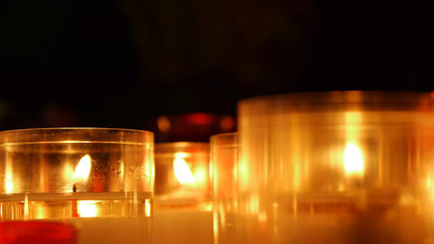 Illuminated candles in a church Footage