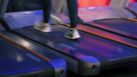 Woman Running on a Treadmill Close Up Shot Footage