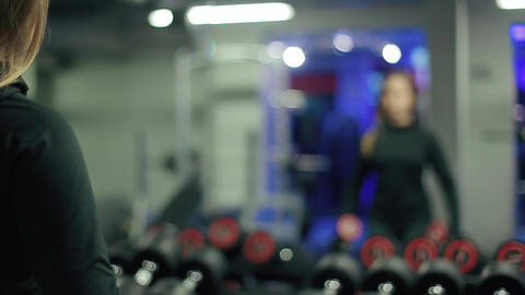 Woman Lifting Dumbbells Weights And Sweating stock footage