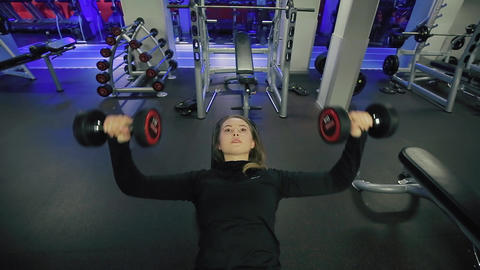 Athletes Lying on Bench and Lifting Dumbbells Footage