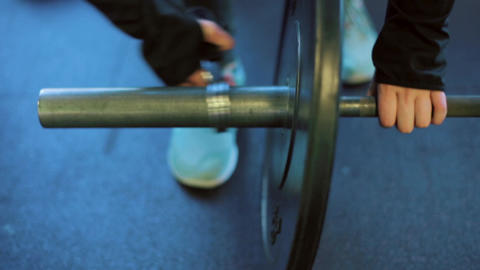 Athlete Putting Weights on Barbell at Gym Slow Mo Footage