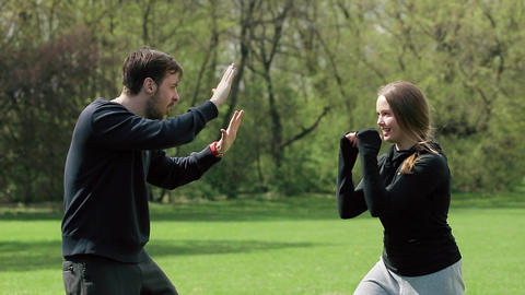Young Couple Playing Together Boxing Outdoors Footage