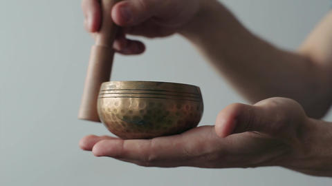 Small Tibetan Singing Bowl Being Made to Sing Footage