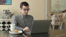 Man Working from Home with Laptop Live Action