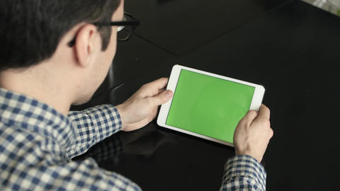 A Man Look a Horizontal Tablet at His Desk Footage