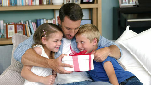 Father receiving gift from his children Footage