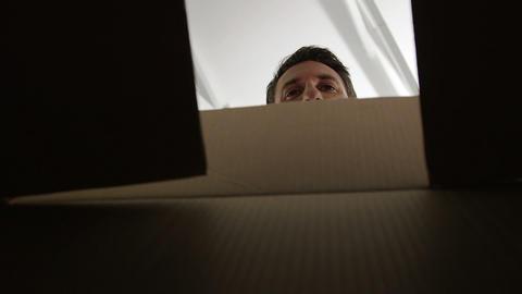 A man opening a cardboard box Footage