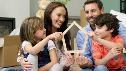 A smiling family of four settling in a new place Footage