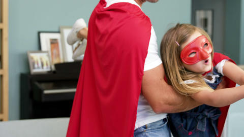 Father and daughter pretending to be superhero Stock Video Footage