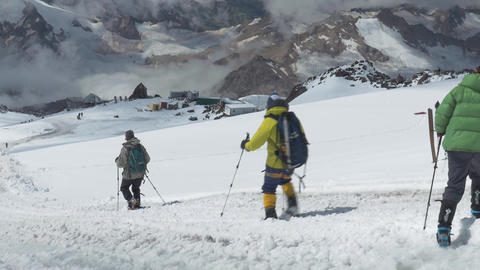 Climbers descend from the top of Elbrus. Panorama of the mountain, a nice sunny GIF