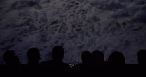 Silhouette of viewers in the cinema while watching a documentary GIF