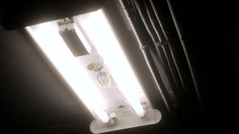 Fluorescent lights flicker on Close Footage