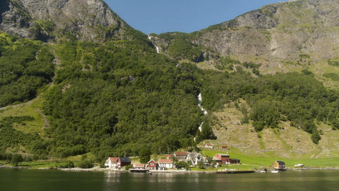 Small Town Under Huge Waterfall in the Fjords of Norway Live Action